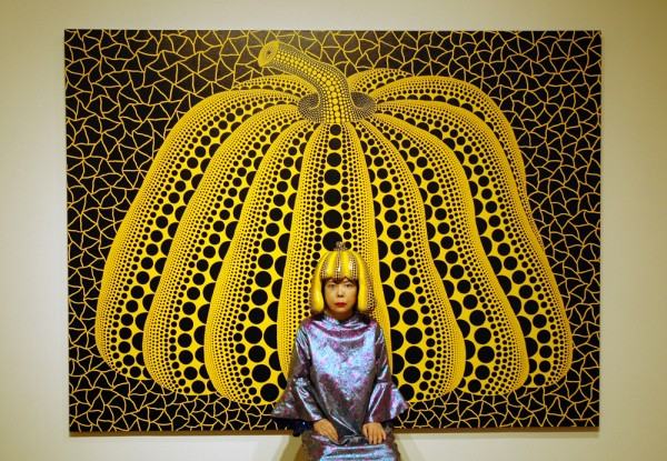 Yayoi Kusama in front of the Pumpkin Series, 2004