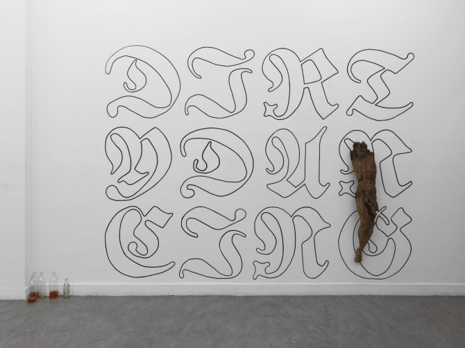 Dirty Dancing, 2013 Calligraphy in pencil and ink, wooden figure (crucifix) 265 × 330 × 20 cm | 104 ⅛ × 129 5/16 × 7 5/16 inches